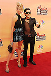 LOS ANGELES, CA- MAY 01: Model Courtney Anne (L) and actor Corey Feldman attend the 2014 iHeartRadio Music Awards held at The Shrine Auditorium on May 1, 2014 in Los Angeles, California.