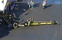 Apr. 13, 2012; Concord, NC, USA: NHRA crew members for top fuel dragster driver Morgan Lucas push his car out ready to be towed to the staging lanes during qualifying for the Four Wide Nationals at zMax Dragway. Mandatory Credit: Mark J. Rebilas-