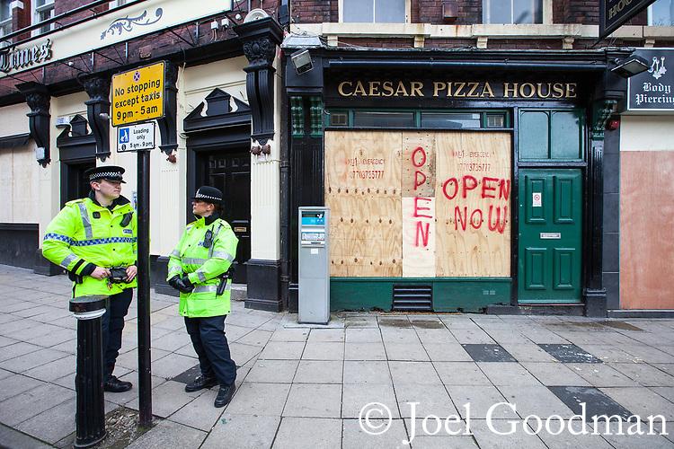 © Joel Goodman - 07973 332324 . 02/04/2011 . Blackburn , UK . Local shops and restaurants board up their windows . The English Defence League ( EDL ) hold a demonstration in Blackburn . Photo credit : Joel Goodman