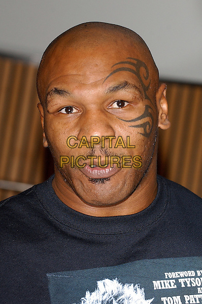 MIKE TYSON .At Big Joe Egan's Autobiograhy Book Signing at Books Etc. Canary Wharf, London, UK..November 17th, 2005.Ref: BEL.headshot portrait mustache facial hair tattoo .www.capitalpictures.com.sales@capitalpictures.com.© Capital Pictures.