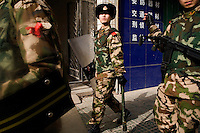 Riot police patrol the streets of Kashgar, Xinjiang, China.  After fighting between Uighurs and Hans in 2009, the government has maintained a heavy police presence in the city.