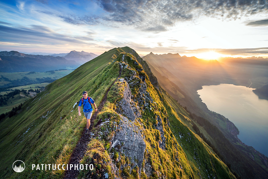 Hiking at sunrise on the famous Hardergrat, aka Brienzergrat, a long ridgeline above the Brienzersee connecting Interlaken with Brienz, Switzerland