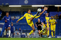 Toby Sibbick of AFC Wimbledon and Chelsea's George McEachran challenge for the ball during Chelsea Under-21 vs AFC Wimbledon, Checkatrade Trophy Football at Stamford Bridge on 4th December 2018
