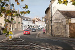 Traffic and historic buildings in the town centre of Melksham, Wiltshire, England, UK