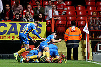 Shrewsbury Town players leap onto Jon Nolan to celebrate their opening goal during Charlton Athletic vs Shrewsbury Town, Sky Bet EFL League 1 Play-Off Football at The Valley on 10th May 2018