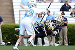 23 April 2016: Notre Dame's Mikey Wynne (24) scores a goal past North Carolina's Jack Rowlett (33). The University of North Carolina Tar Heels hosted the University of Notre Dame Fighting Irish at Kenan Stadium in Chapel Hill, North Carolina in a 2016 NCAA Division I Men's Lacrosse match. UNC won the game 17-15.
