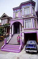 Old colorfull painted wooden victorian style houses in San Francisco, California, USA