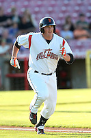 Skyler Ewing #44 of the Salem-Keizer Volcanoes runs to first base during a game against the Spokane Indians at Volcanoes Stadium on July 26, 2014 in Keizer, Oregon. Spokane defeated Salem-Keizer, 4-1. (Larry Goren/Four Seam Images)