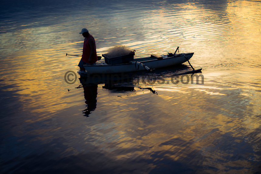 Teahupoo, Tahiti Iti, French Polynesia. Sunday 19 August 2012. A fisherman heads out at sunset. The Billabong Pro Tahiti was called off today for the second day in a row due to small surf conditions. Photo: joliphotos.com