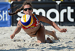 ST. PETERSBURG, FL - JUNE 18: Brooke Sweat dives to dig ball during the FIVB Beach Volleyball World Tour St. Petersburg Grand Slam presented by the AVP on June 18, 2015 at Spa Beach in St. Petersburg, Florida. (Photo by Donald Miralle for the AVP)
