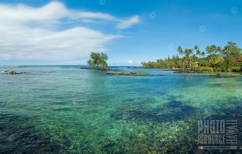 Distant beachgoers enjoy a restful day at Leleiwi Beach Park, Hilo, Big Island.
