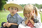 ROBERT WALKER, 4, of Coram, and JULIAN LYNN ZOLL, 6, of Levittown, wear clothes of American Civil War era while portraying family members of Union soldiers at Camp Scott re-creation, at Old Bethpage Village Restoration, to commemorate 150th Anniversary of American Civil War, on Saturday, July 21, 2012, in Old Bethpage, New York, USA.