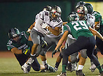 Torrance, CA 10/09/15 - Jeremiah Aiono (Torrance #28), Sean Fitzgerald (South #42) and Tanner Thompson (South #29) in action during the Torrance vs South High varsity football game.  South defeated Torrance 24-21.