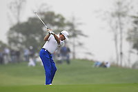 Graeme McDowell (NIR) plays his 2nd shot on the 1st hole during Saturay's Round 3 of the 2014 BMW Masters held at Lake Malaren, Shanghai, China. 1st November 2014.<br /> Picture: Eoin Clarke www.golffile.ie