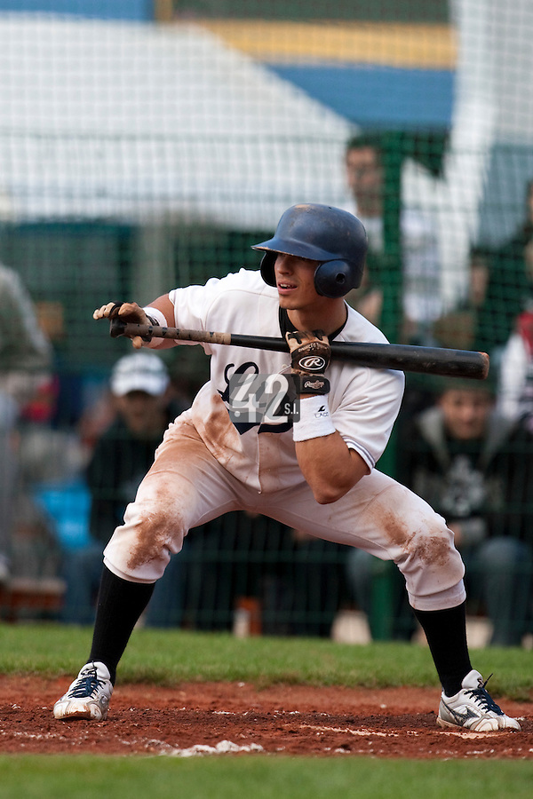 10 october 2009: Yann Dal Zotto of Savigny attempts a bunt during to game 3 of the 2009 French Elite Finals won 4-2 by Savigny over Rouen, at Stade Jean Moulin stadium in Savigny sur Orge, near Paris, France.
