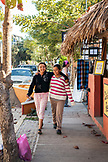 MEXICO, San Pancho, San Francisco, two young local girls take a stroll along the shops near San Pancho Beach
