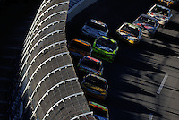 Nov. 1, 2009; Talladega, AL, USA; NASCAR Sprint Cup Series drivers race through the tri-oval past the redesigned catch fence during the Amp Energy 500 at the Talladega Superspeedway. Mandatory Credit: Mark J. Rebilas-