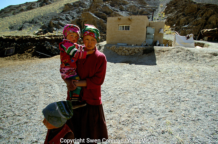 A family living at 4500 meters next to the Chinese frontier, in the Marco Polo region..The M41 Highway from the Ismaili capital of Khorog to the south capital of Kyrgyzstan - Osh, via the head district of Badakhshan - Murgab and the Akbajtal Pass at 4655 meters.