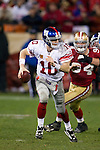 New York Giants quarterback Eli Manning (10) scrambles out of the pocket during an NFC Championship NFL football game against the San Francisco 49ers on January 22, 2012 in San Francisco, California. The Giants won 20-17 in overtime. (AP Photo/David Stluka)