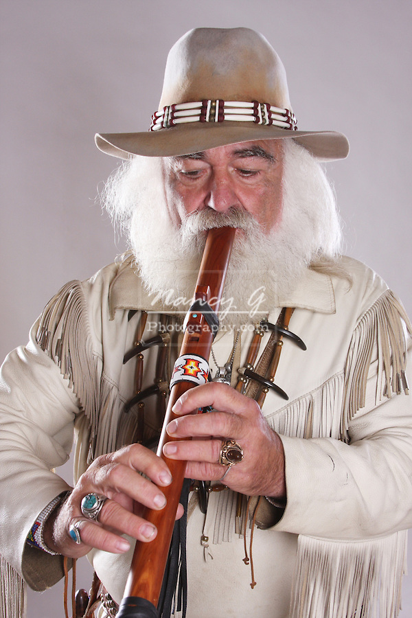 A Native American Indian man playing the flute