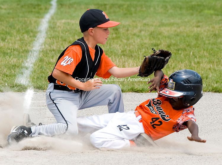 WATERBURY, CT-0712117JS08--Bonnie's Joshua Victor (42) slides safely under the tag by Water-Oak's Alex Halpert (34) during their consolation bracket game in the Roberto Clemente Tournament Thursday at the Waterbury PAL field. <br /> Jim Shannon Republican-American