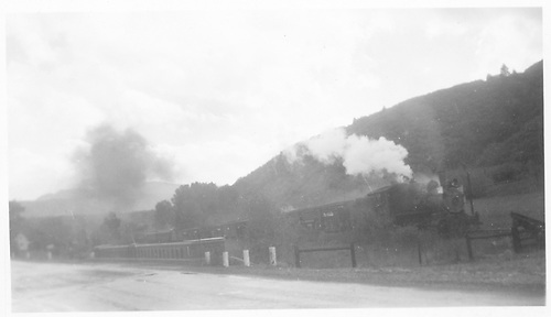 Wide-angle view of freight train at unidentified location.  Probable RGS.<br /> RGS