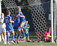 Boston Breakers forward Kyah Simon (17) celebrates her goal with teammates.  In a National Women's Soccer League (NWSL) match, Boston Breakers (blue) tied Western New York Flash (white), 2-2, at Dilboy Stadium on August 3, 2013.