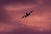 A Lockheed P-3C Orion Maritime reconnaissance aircraft with the Japanese Maritime Self Defence Force patrolling at sunset above Chou Rinkan in Kanagawa, Japan. Tuesday September 27th 2016