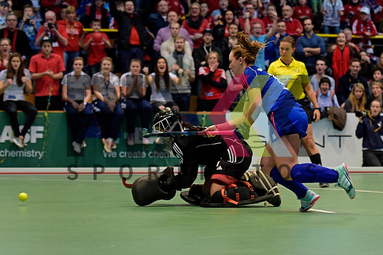 GER - Luebeck, Germany, February 07: During the 1. Bundesliga Damen indoor hockey final match at the Final 4 between Mannheimer HC (blue) and Duesseldorfer HC (white) on February 7, 2016 at Hansehalle Luebeck in Luebeck, Germany. Final score 6-4 after shootout.  Nike Lorenz #16 of Mannheimer HC tries to score during shoot-out; Nathalie Kubalski (TW) #1 of Duesseldorfer HC