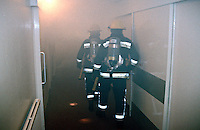 Firefighters in breathing apparatus searching a heavily smoke logged house thats on fire for a child that they believe that is in a first floor bedroom. This image may only be used to portray the subject in a positive manner..©shoutpictures.com..john@shoutpictures.com