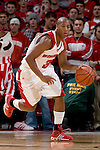 MADISON, WI - NOVEMBER 3: Guard Trevon Hughes #3 of the Wisconsin Badgers handles the ball against the University of Wisconsin-Stout Blue Devils at the Kohl Center on September 3, 2006 in Madison, Wisconsin. The Badgers beat the Blue Devils 82-33. Photo by David Stluka