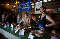 Louise Pagano, left, and Jenny Shultz, an associate pastor at the United Church of Chapel Hill, chat while selling coffee and pastries at the Wild Goose Festival Coffee Barn on June 22, 2012, at the Shakori Hills Community Arts Center in Pittsboro, NC. Proceeds from sales went to support the church's mission trips.