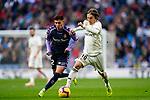 Luka Modric of Real Madrid (R) fights for the ball with Leonardo Gabriel Suarez, Leo Suarez, of Real Valladolid during the La Liga 2018-19 match between Real Madrid and Real Valladolid at Estadio Santiago Bernabeu on November 03 2018 in Madrid, Spain. Photo by Diego Souto / Power Sport Images