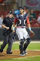 South Division catcher Jhonny Pereda (15) of the Myrtle Beach Pelicans watches a foul pop fly as home plate umpire Austin Jones looks on during the 2018 Carolina League All-Star Classic at Five County Stadium on June 19, 2018 in Zebulon, North Carolina. The South All-Stars defeated the North All-Stars 7-6.  (Brian Westerholt/Four Seam Images)