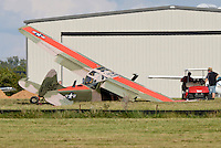 NWA Democrat-Gazette/BEN GOFF @NWABENGOFF<br /> A small airplane sits to the side of the runway with damage visible to the landing gear, wing and propeller on Sunday Sept. 27, 2015 at Bentonville Municipal Airport.