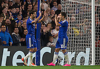 Eden Hazard (R) of Chelsea congratulates goalscorer Cesc Fabregas (L) of Chelsea during the UEFA Champions League match between Chelsea and Maccabi Tel Aviv at Stamford Bridge, London, England on 16 September 2015. Photo by Andy Rowland.