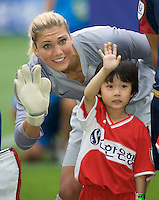 Hope Solo, Korean boy.  The USWNT defeated Canada, 1-0, at Suwon World Cup Stadium in Suwon, South Korea, to win the Peace Queen Cup.