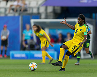 GRENOBLE, FRANCE - JUNE 18: Konya Plummer #5 of the Jamaican National Team passes the ball during a game between Jamaica and Australia at Stade des Alpes on June 18, 2019 in Grenoble, France.