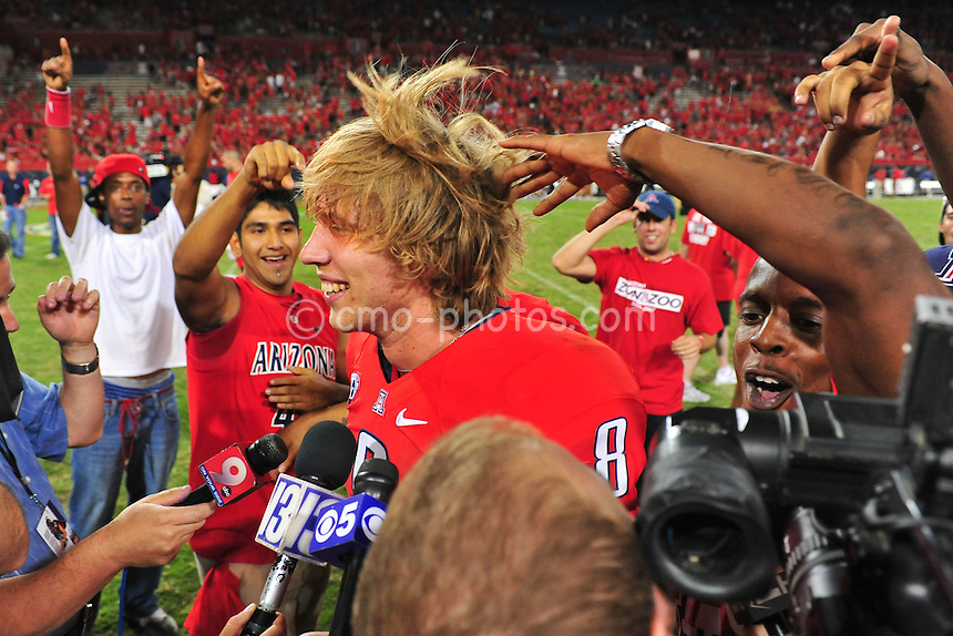 Sept 18, 2010; Tucson, AZ, USA; Arizona Wildcats quarterback Nick Foles (8) gets his hair messed up during an interview after a game against the Arizona Wildcats at Arizona Stadium. Arizona won the game 34-27.