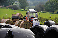 Wrapping big silage bales with Conor Bale Wrap and Massey Ferguson 390, Whitewell, Lancashire....Copyright..John Eveson, Dinkling Green Farm, Whitewell, Clitheroe, Lancashire. BB7 3BN.01995 61280. 07973 482705.j.r.eveson@btinternet.com.www.johneveson.com