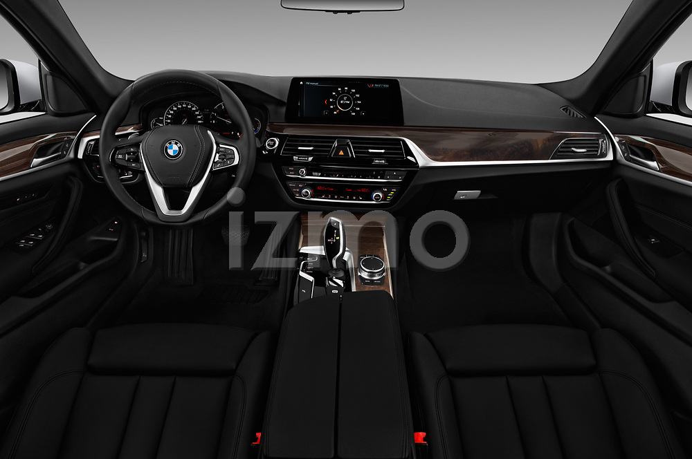 Stock photo of straight dashboard view of a 2018 BMW 5 Series 530i 2WD 4 Door Sedan
