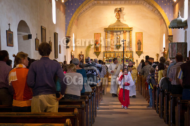 Altar girls lead the procession of clergy as they exit the chapel during Easter Service, Mission San Antonio de Padua, California.