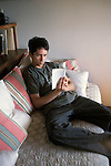 Berkeley, CA  Half latino boy, seventeen years old, reading for pleasure alone at home  MR