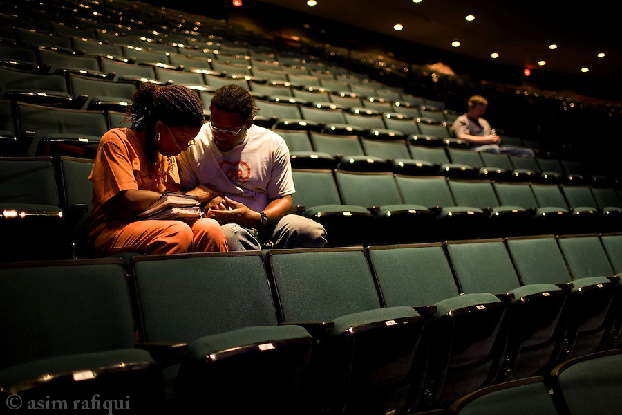 A couple shares a quiet moment in prayer after afternoon services at the Lakewood Church in Houston, Texas.  lakewood is possibly the largest evangelical church in america, constructed inside what was once a football stadium.  pastor joel oelsteen and his wife run a multi-million dollar religious services program from this church.  the program has interests in book publishing, broadcasting, and internet based distribution and publishing concerns.