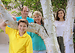 """August 9, 2016  copyright Genesis/Jim Mendenhall 2016<br /> Family portrait for """"Why I love Being a Child Sponsor"""" column. (note- Sarah Krushinski told the photographer not to publish her middle name shown on the assignment which is McGraw.)  Ids- The father is Scott Krushinski. Mother is Sarah Krushinski. Daughter is Helen Krushinski and son is Logan Krushinski.  Shown at their home in Wexford , PA (fyi- Wexford is a mailing address but not a municipality- it's an oddity in the area.) Details of letters from their sponsored child in Kenya with photo of her when she as 5 years old.  Sarah said she was surprised to find that Family Christian Bookstore at the checkout offered her an opportunity to sponsor a child with World Vision as she was not familiar with the sponsorship program. The bookstore had the paper work  with the photo of the exact child on hand.  Also of note, Sarah picked a five year old at the time because that was then the age of their youngest child, Logan.  Their home is at 157 Fox Meadow Drive, Wexford, PA  15090. (only about 10 miles from the WV warehouse in Sewickley, PA) Details show letters from their child in Kenya whose name is in the materials photographed. Sarah was not sure about the propriety of showing the childs full name which is why the signature  and her name in the printed materials is not shown."""