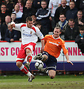 Michael Bostwick of Stevenage Borough and Liam Hatch of Luton (on loan from Peterborough)  challenge during the  Blue Square Premier match between Stevenage Borough and Luton Town at the Lamex Stadium, Broadhall Way, Stevenage on Saturday 3rd April, 2010..© Kevin Coleman 2010 .