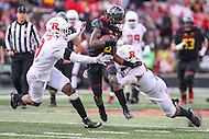 College Park, MD - November 26, 2016: Maryland Terrapins wide receiver Levern Jacobs (8) gets tackled by serveral Rutgers Scarlet Knights defenders during game between Rutgers and Maryland at  Capital One Field at Maryland Stadium in College Park, MD.  (Photo by Elliott Brown/Media Images International)