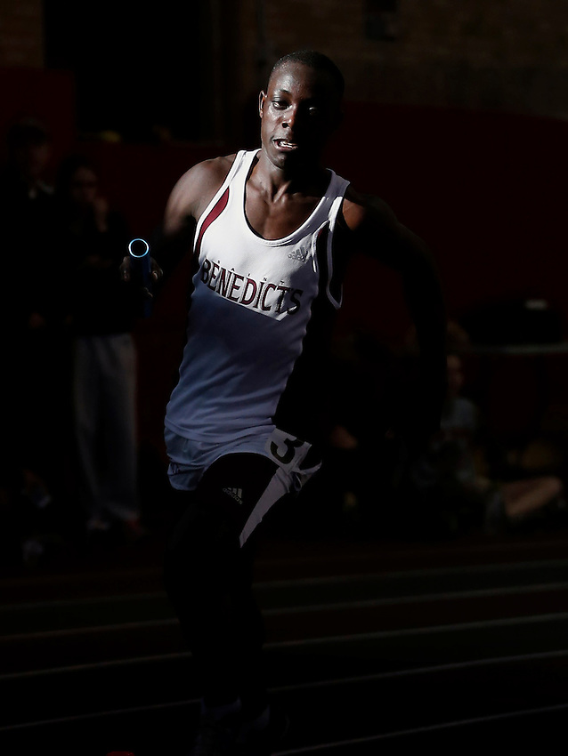 JERSEY CITY, NJ - (Jan. 6, 2013) -St. Benedict's Edward Cheserek emerges from the shadows in 5th place to make up a 6 second deficit on the anchor leg to easily win the boys sprint medley relay at the 2013 Essex County Indoor Track Relays at the Jersey City Armory.