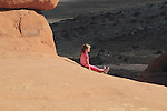 Girl in Arches National Park, Moab, Utah, USA. .  John offers private photo tours in Arches National Park and throughout Utah and Colorado. Year-round.