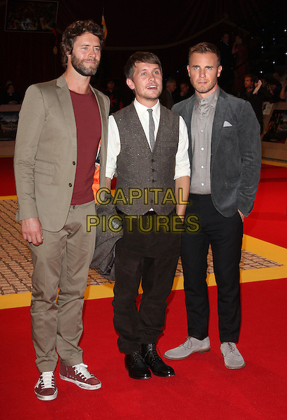 Howard Donald, Mark Owen & Gary Barlow of Take That.'The Three Musketeers in 3D' world film premiere, Vue cinema, Westfield, London, England. 4th October 2011.full length beige trousers red maroon top grey gray waistcoat white shirt blue suit jacket band group beard facial hair .CAP/ROS.©Steve Ross/Capital Pictures